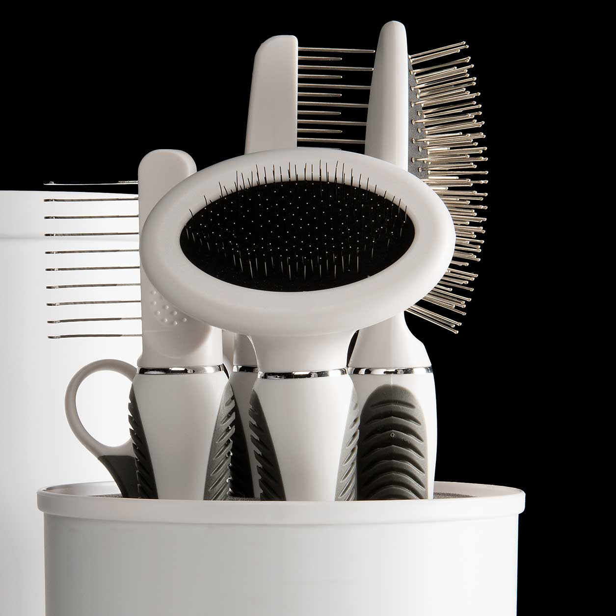 Longhair Grooming Kit tools standing upright in container