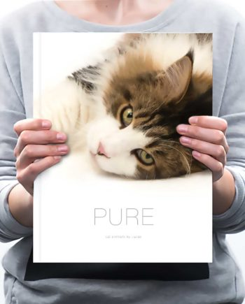 Woman holding Pure Cat Book