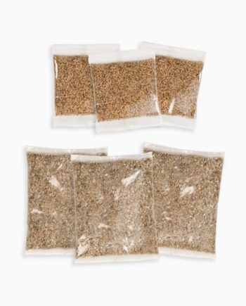 Senses 2.0 Grass Kit containing 3 sets of seeds and vermiculite on white background