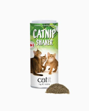 Catnip shaker with some catnip in front of it on white background
