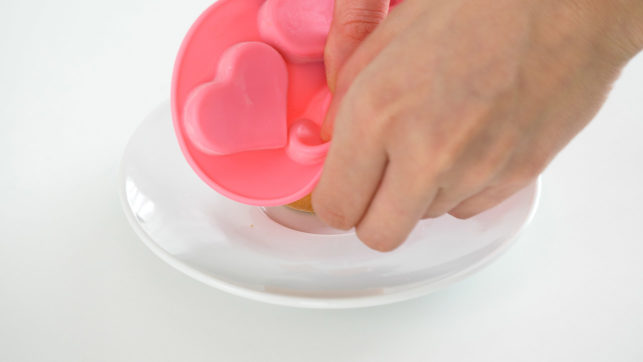 43860_Silicone Heart-Shaped Ice Cube Tray - 4. Push down on the silicone to pop the ice treats out.